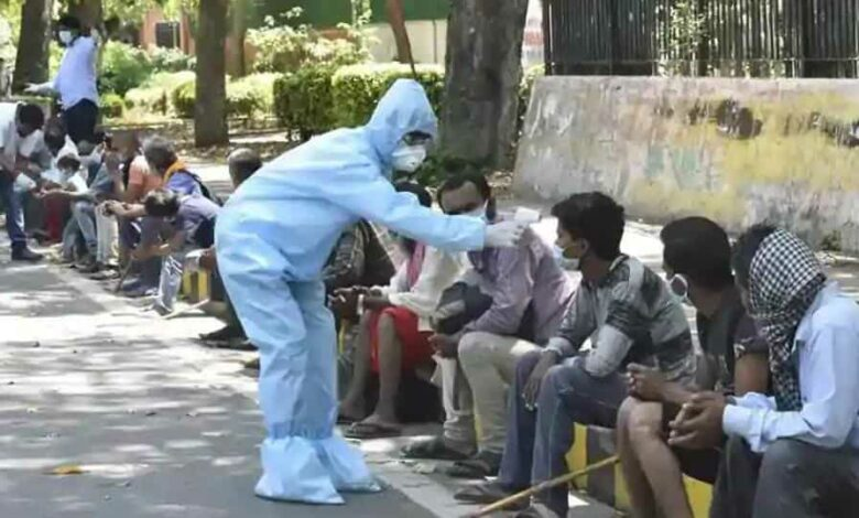 People are thermal screened and sensitized about the coronavirus by workers in PPE