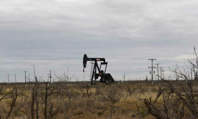 A pump jack operates in the Permian Basin oil and natural gas production area near Odessa, Texas.