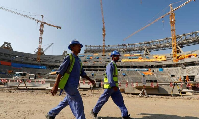 FILE PHOTO: Workers are seen inside the Lusail stadium which is under construction for the upcoming 2022 Fifa soccer World Cup