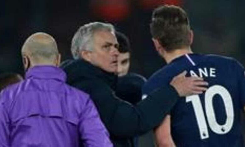 Tottenham Hotspur manager Jose Mourinho with Harry Kane as he goes off injured.