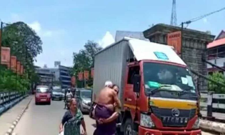 The person was seen carrying his 65-year-old ailing father in his arms. The incident took place in Kerala's Punalur area on Wednesday.