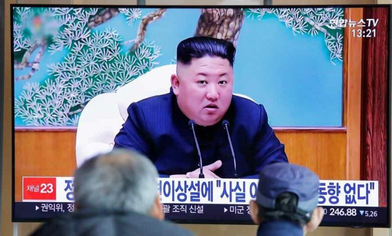 FILE PHOTO: South Korean people watch a TV broadcasting a news report on North Korean leader Kim Jong Un in Seoul, South Korea, April 21, 2020. REUTERS/Heo Ran/File Photo