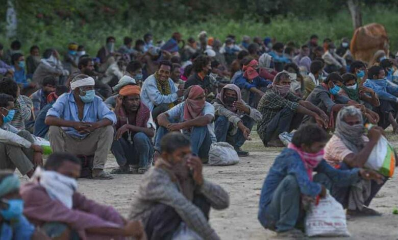 Migrant workers and homeless gathered on the banks of Yamuna River before shifting them to the shelter homes, during lockdown to check the spread of coronavirus, near Kashmiri Gate, in New Delhi, India, on Wednesday, April 15, 2020.