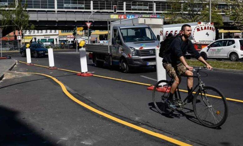 A cyclist uses a new temporary cycle lane in Berlin, Germany, on Wednesday, April 22, 2020.