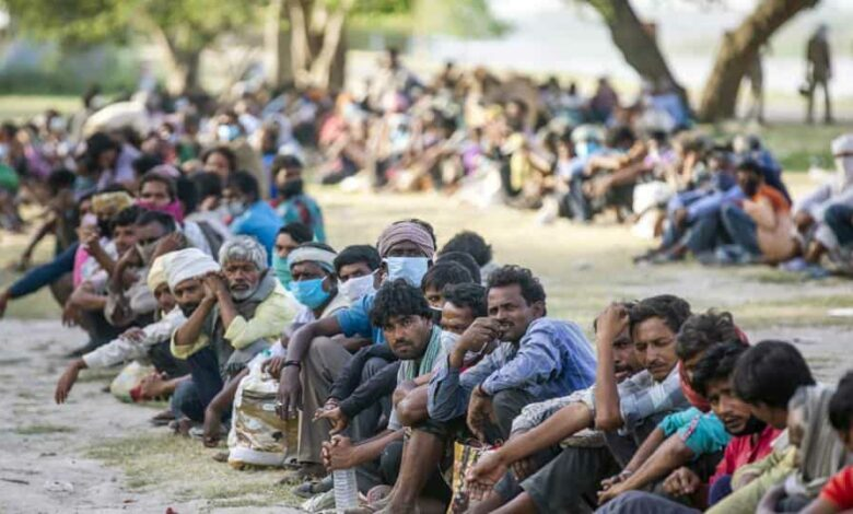 Covid-19 lockdown: People wait in lines on the banks of Yamuna River to be transferred to a shelter during a lockdown imposed due to the coronavirus in New Delhi on Wednesday, April 15, 2020.