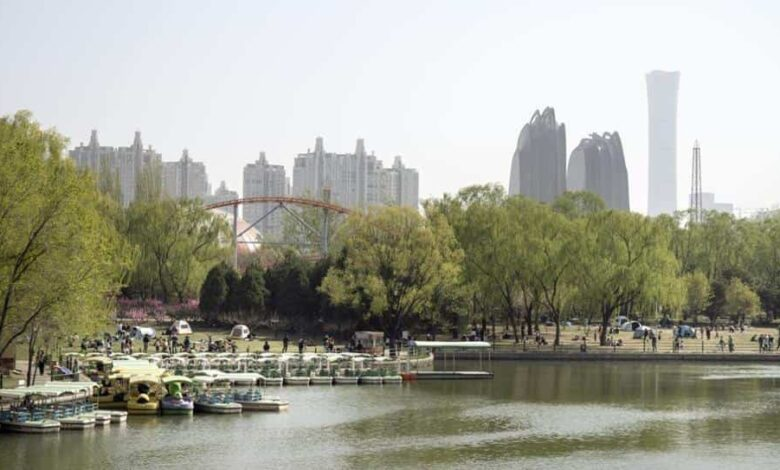 Pleasure boats stand moored by the lake in Chaoyang Park in Beijing, China, on Saturday April 4, 2020. China reported no new coronavirus deaths for the first time since the pandemic emerged, adding to signs that the crisis may be easing in some areas.