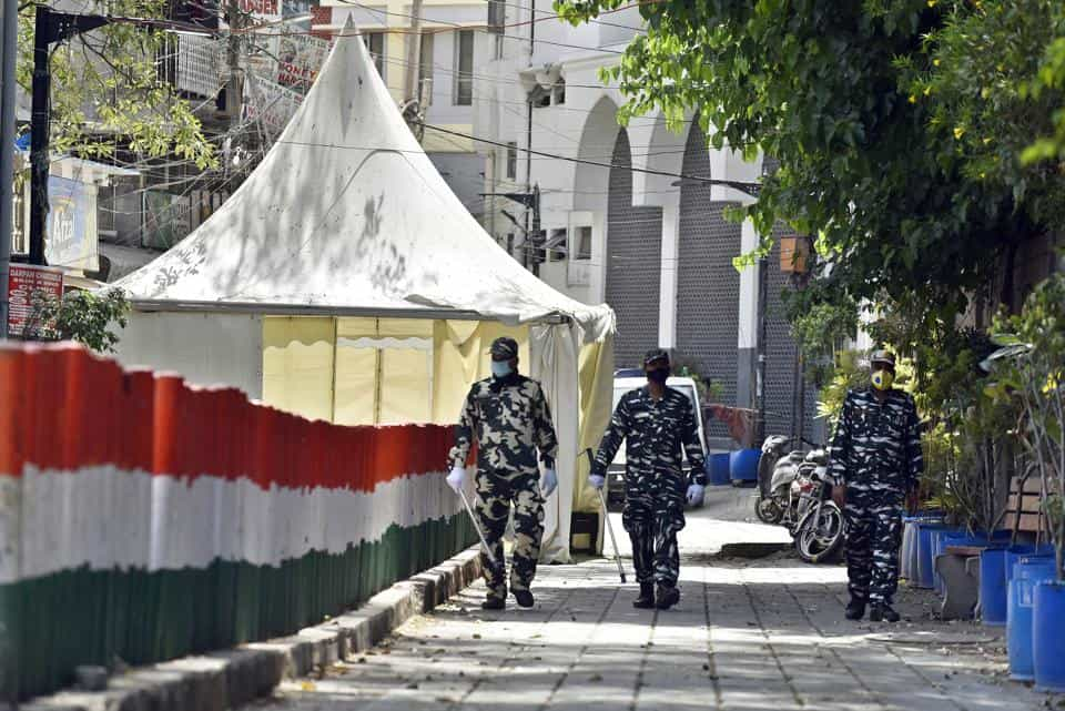 Covid-19: Paramilitary personnel seen at the cordoned off entry route to the Tablighi Jamaat