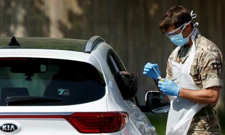 A member of the military conducts a Covid-19 check-up at a drive-thru testing site in Chessington, London, on April 24.