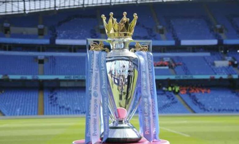 FILE - In this Sunday, May 6, 2018 file photo the English Premier League trophy sits on the pitch prior to the English Premier League soccer match between Manchester City and Huddersfield Town at Etihad stadium.