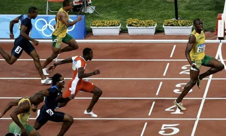 Usain Bolt celebrates at the finish line after winning the 100 m sprint at the 2008 Olympics.