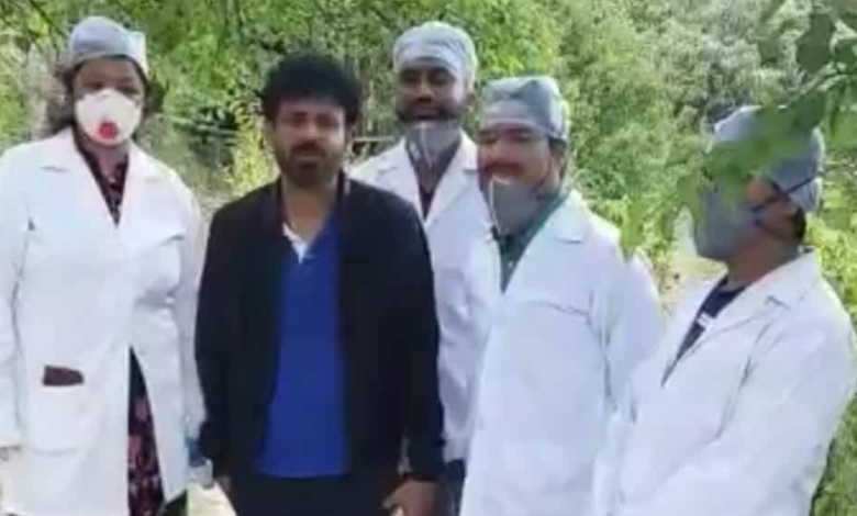 Manoj Bajpayee with the health team that screened him in Nainital on Wednesday.