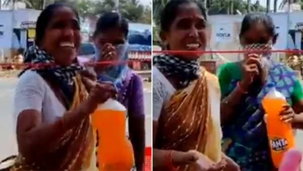Viral Video shows that a poor woman serves cool drinks for policemen in Andhra