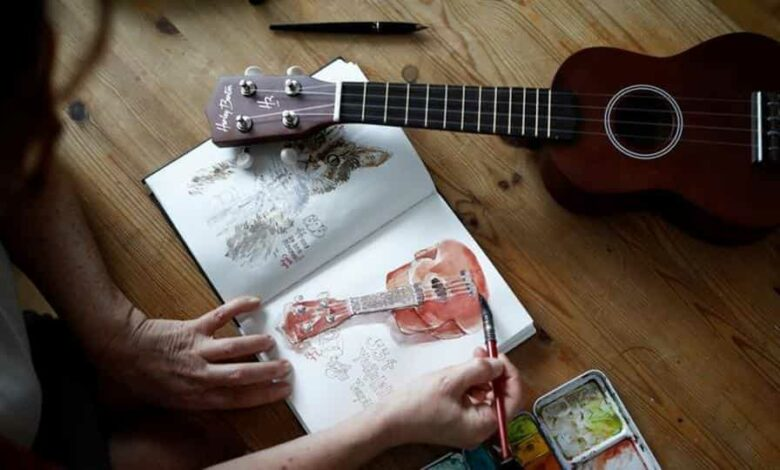 Agnes Goyet, a Parisian artist who documented life in lockdown in a journal during the coronavirus disease (COVID-19) outbreak, paints on paper with watercolours in her apartment in Paris, France.