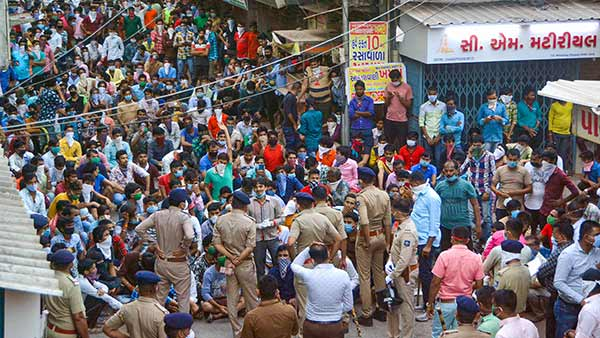 Coronavirus Lockdown extension: Gujarat: Migrant workers hit streets in Surat