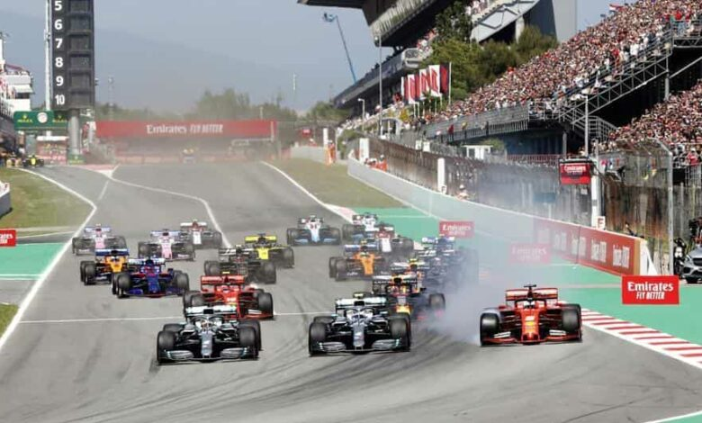 Mercedes driver Lewis Hamilton, left, of Britain leads the field after the start of the Spanish Formula One race.