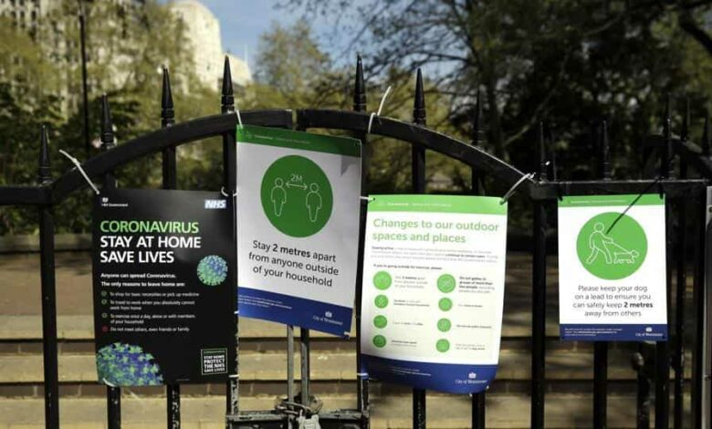 Coronavirus guideline signs are displayed by an entrance to Victoria Embankment Gardens in London, during the lockdown to try and stop the spread of coronavirus.