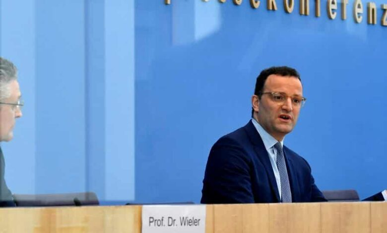 German Health Minister Jens Spahn speaks next to the head of the Robert Koch Institute for disease control Lothar H. Wieler, during a news conference on the situation in Germany.