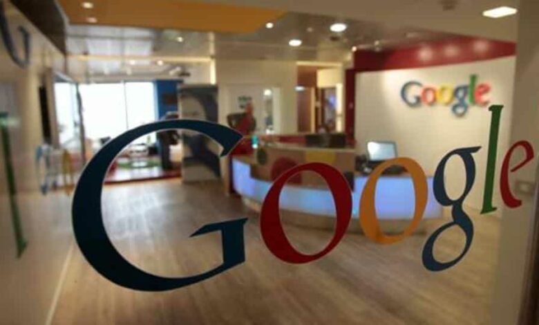 The Google logo seen on a door at the company