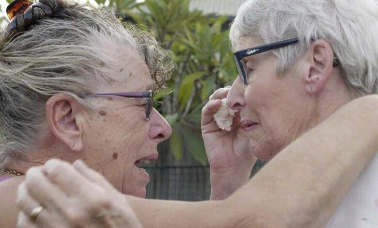 Christine Archer, right, and her sister Gail Baker cry as they are reunited in Bowraville, Australia.