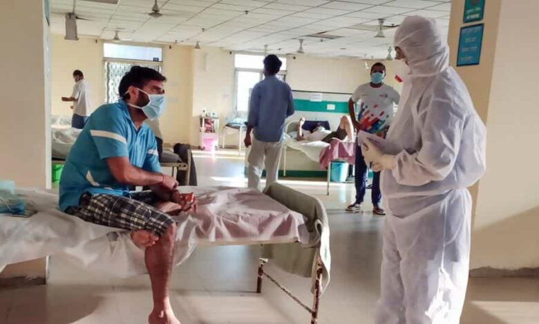 A patient interacts with a medic at a hospital, during the ongoing Covid-19 lockdown, in New Delhi on Saturday.