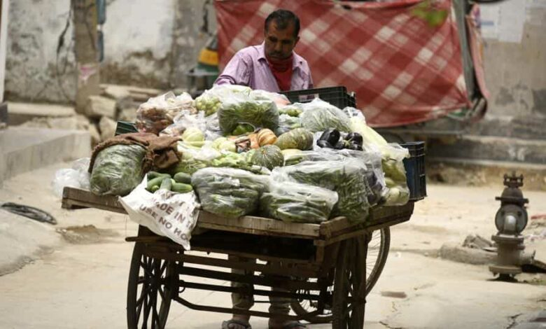 A vegetable vendor selling produce on a cycle cart makes the rounds in the Om Nagar coronavirus containment zone during lockdown in Sector-11 near National Highway-48, in Gurugram.