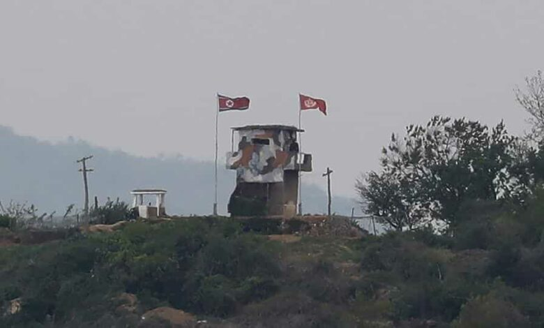 A North Korean flag flutters in the wind at a military guard post in Paju, at the border with North Korea, Sunday, May 3, 2020. North and South Korean troops exchanged fire along their tense border on Sunday, the South