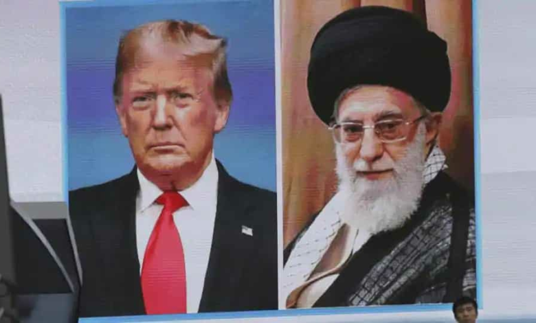 A man walks by a huge screen showing U.S. President Donald Trump, left, and Iranian Supreme Leader Ayatollah Ali Khamenei, in Tokyo.