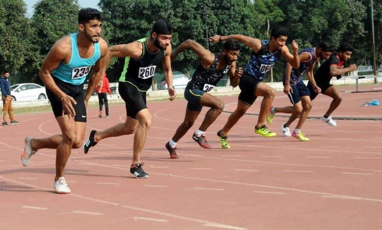 Athletes in action during the men Under -25 Punjab State Games organized by Sports Department Punjab at Polo Ground in Patiala.