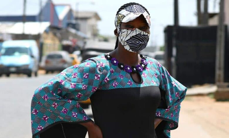 Nigerian fashion stylist, Angela Innocent, 38, poses for a picture with a fabric face mask matching her hat, following the spread of the coronavirus disease (COVID-19) in Lagos, Nigeria May 13, 2020. Picture taken May 13, 2020.