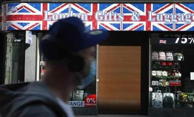A closed tourist souvenir shop on Oxford Street in London, as the country is in lockdown to help curb the spread of the coronavirus, Wednesday, April 15, 2020.