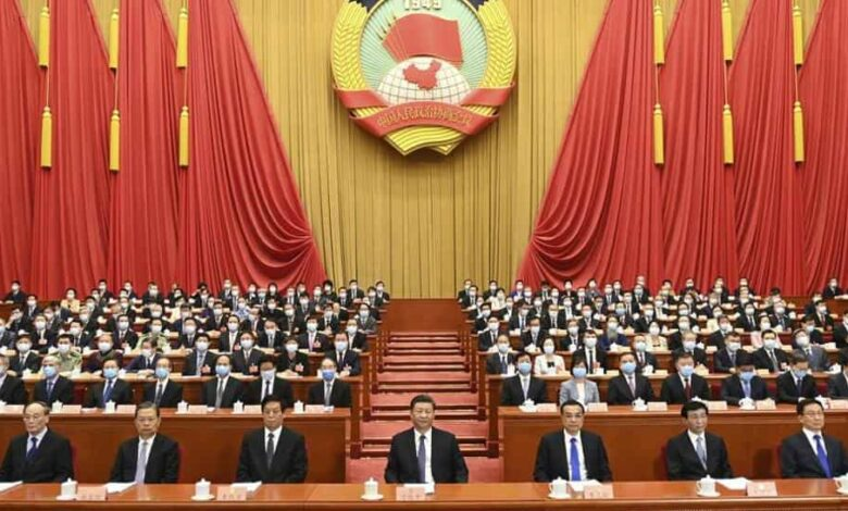 In this photo released by Xinhua News Agency, Chinese President Xi Jinping, center, attends the opening session of the Chinese People
