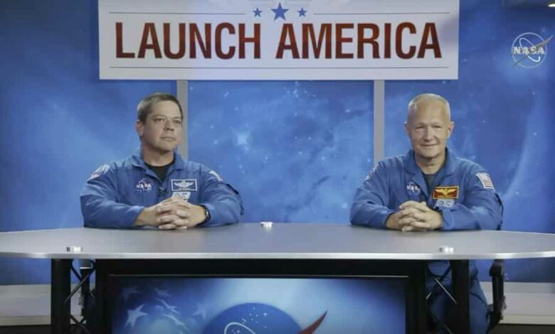 In this image from video made available by NASA, astronauts Bob Behnken, left, and Doug Hurley give a news conference at the Johnson Space Center in Houston on Friday, May 1, 2020. The two are scheduled for a May 27 launch aboard a SpaceX rocket to the International Space Station.
