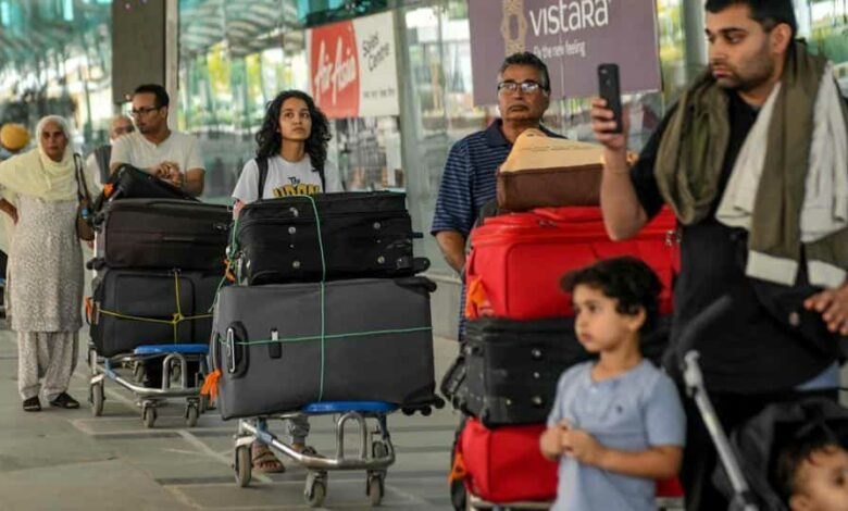 Canadian nationals queue to check-in before boarding a special flight for New Delhi.