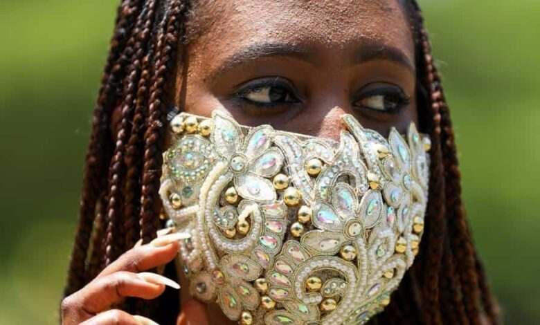 Nigerian fashion stylist Sefiya Diejomoah, 35, poses for a picture with a blinged-out face mask matching with her clothes, following the spread of the coronavirus disease (COVID-19) in Lagos, Nigeria May 14, 2020. Picture taken May 14, 2020. REUTERS/Temilade Adelaja