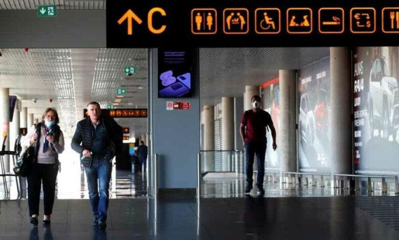 People walk in the terminal as flights resume during the coronavirus disease (COVID-19) outbreak in Riga international airport, Latvia May 18, 2020. REUTERS/Ints Kalnins