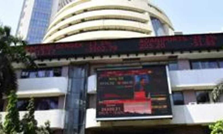 People walk by screen installed in BSE in Mumbai, India, on Monday, March 23, 2020.