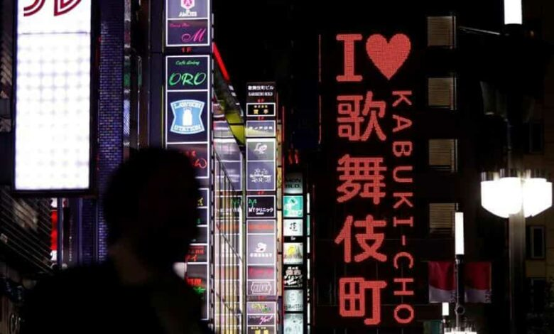 A passerby is seen in Kabukicho nightlife district, during a state of emergency to fight the coronavirus disease (COVID-19) outbreak, in Tokyo.