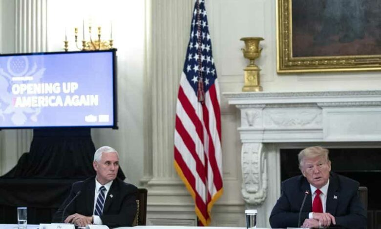US President Donald Trump, right, speaks as Vice President Mike Pence listens during a meeting at the White House. Pence's press secretary Katie Miller has tested positive for the coronavirus.