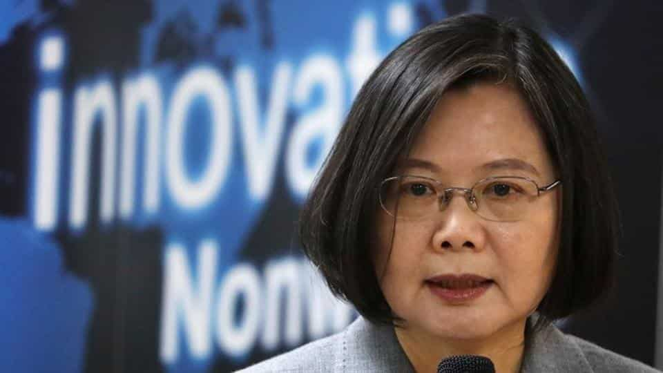 Taiwanese president Tsai Ing-Wen speaks at a non woven filter fabric factory, where the fabric is used to make surgical face masks, in Taoyuan, Taiwan, March 30, 2020. REUTERS/Ann Wang/Files