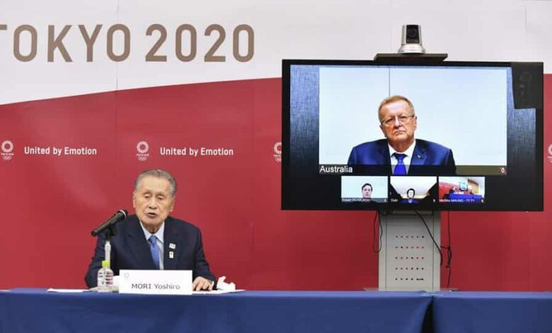 FILE - In this April 16, 2020, file photo, Tokyo 2020 Organizing Committee President Yoshiro Mori, left, speaks in teleconference with John Coates, chairman of the IOC