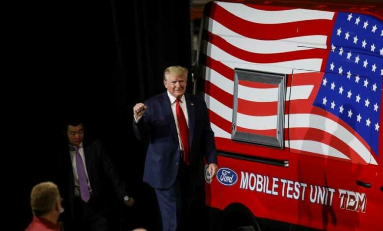 US President Donald Trump walks past a mobile test vehicle as he arrives to speak during a visit at the Ford Rawsonville Components Plant, which is making ventilators and medical supplies, during the coronavirus disease pandemic in Ypsilanti, Michigan.