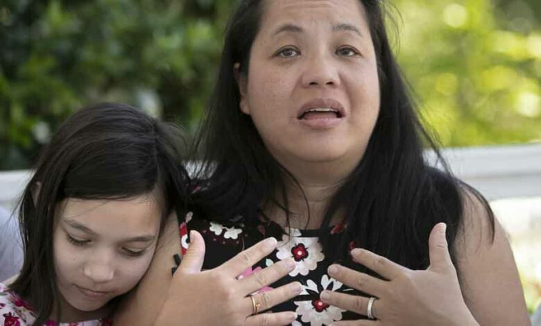 Juliet Daly, 12, sits with her mother Jennifer Daly, as she recounts the ordeal of almost losing Juliet, on the front porch of their family home in Covington, La., Thursday, April 30, 2020.