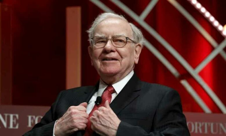 Warren Buffett, chairman and CEO of Berkshire Hathaway, takes his seat to speak at the Fortune