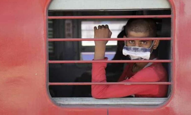 A migrant workers sits inside a special train to return to Agra in Uttar Pradesh during a nationwide lockdown to curb the spread of coronavirus at a railway station in Ahmedabad.