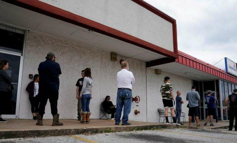 People who lost their jobs wait in line to file for unemployment following an outbreak of the coronavirus disease  at an Arkansas Workforce Center in Fayetteville, Arkansas, US on April 6, 2020.