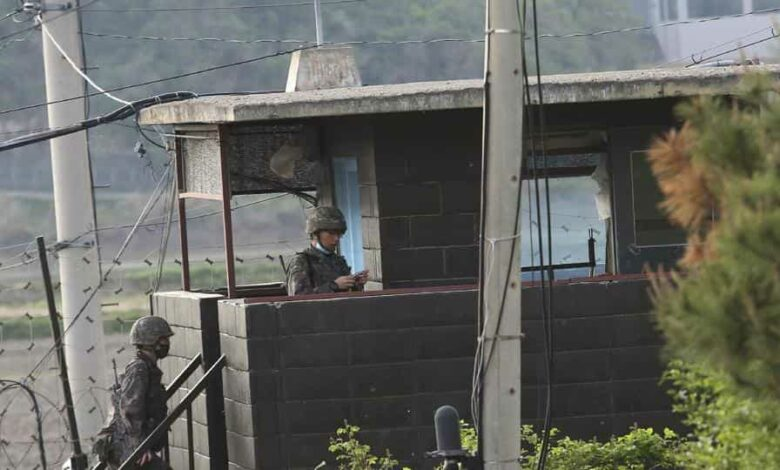 Army soldiers walk up the stairs of their military guard post in Paju, South Korea, near the border with North Korea, Sunday, May 3, 2020. North and South Korean troops exchanged fire along their tense border on Sunday, the South