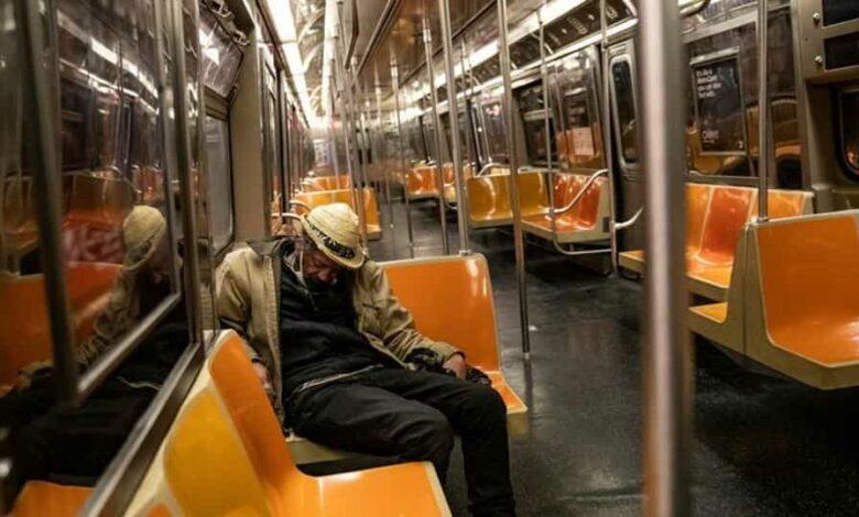 A passenger sleeps inside an MTA subway car, during the outbreak of the coronavirus disease in New York City, in this file photo.